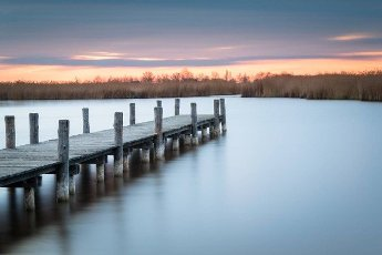 Jetty on lake Neusiedlersee in Burgenland long exposure on a morning