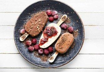 Popsicle ice cream with chocolate and cherry.Ice cream sticks