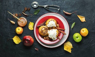 Baked apples stuffed with oatmeal and nuts.Copy space