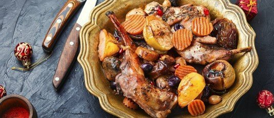 Braised rabbit meat with fruits.Baked meat for the Christmas table. Christmas dish.