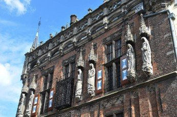 facade of the old town hall of Kampen in the Netherlands