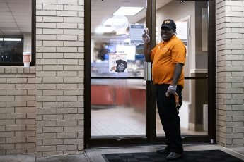 March 30, 2020 - Houston, Texas USA: Houston After Dark - An employee of Whataburger, open 24 hours, arrives for work at midnight during the outbreak of Covid-19, March 31, 2020 (F. Carter Smith/Polaris)