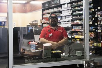 March 30, 2020 - Houston, Texas USA: Houston After Dark - A convenience store employees said that he was doing fine, but very tired, while working all night at the Circle K Valero gas station during the outbreak of Covid-19, March 31, 2020 (F. Carter Smith/Polaris)