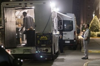 Houston After Dark - A customer practices safe distancing as he waits for his order to be prepared at the Happy Plate Express food truck next to the Harris County Sheriff