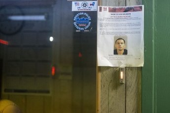 March 30, 2020 - Houston, Texas USA: Houston After Dark - A reward notice, ÃWanted for MurderÃ, hangs at the Admiral Motel near midnight during the outbreak of Covid-19, March 31, 2020 (F. Carter Smith/Polaris)