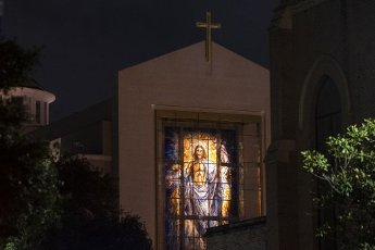 March 31, 2020 - Houston, Texas USA: Houston After Dark - Jesus looks over downtown Houston from the Co-Cathedral of the Sacred Heart, which remains closed, but will be streaming a live Easter mass, during the outbreak of Covid-19, March 31, 2020 (F. Carter Smith/Polaris)