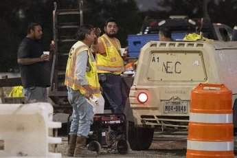 March 30, 2020 - Houston, Texas USA: Houston After Dark - Utility workers take a midnight break near road construction in downtown Houston, Texas during the outbreak of Covid-19, March 31, 2020 (F. Carter Smith/Polaris)