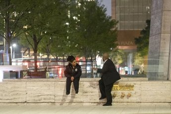 March 31, 2020 - Houston, Texas USA: Houston After Dark - Two security guards take a break outside of One Shell Plaza after midnight in downtown Houston during the outbreak of Covid-19, March 31, 2020 (F. Carter Smith/Polaris)