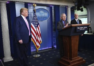 April 10, 2020 - Washington, DC, United States: Dr. Anthony Fauci, director of the National Institute of Allergy and Infectious Diseases, speaks as President Donald Trump and Vice President Mike Pence listen at a Coronavirus briefing at the White House. With the U.S. death toll from the coronavirus pandemic expected to peak over the weekend, most of the country will be firmly under stay-at-home orders on Easter Sunday. (Polaris)
