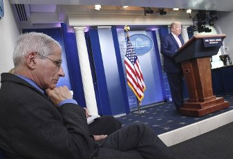 April 10, 2020 - Washington, DC, United States: Dr. Anthony Fauci, director of the National Institute of Allergy and Infectious Diseases, listens as President Donald Trump speaks at a Coronavirus briefing at the White House. With the U.S. death toll from the coronavirus pandemic expected to peak over the weekend, most of the country will be firmly under stay-at-home orders on Easter Sunday. (Polaris)