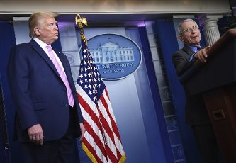April 10, 2020 - Washington, DC, United States: Dr. Anthony Fauci, director of the National Institute of Allergy and Infectious Diseases, speaks as President Donald Trump listens at a Coronavirus briefing at the White House. With the U.S. death toll from the coronavirus pandemic expected to peak over the weekend, most of the country will be firmly under stay-at-home orders on Easter Sunday. (Polaris)
