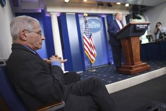 April 10, 2020 - Washington, DC, United States: Dr. Anthony Fauci, director of the National Institute of Allergy and Infectious Diseases, listens as President Donald Trump speaks at a Coronavirus briefing at the White House on Friday, April 10, 2020, in Washington, DC.ÃWith the U.S. death toll from the coronavirus pandemic expected to peak over the weekend, most of the country will be firmly under stay-at-home orders on Easter Sunday. Photo by Kevin Dietsch/UPI