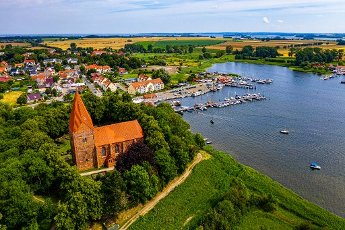 Aerial of Kirchdorf, Church village with its harbour on Poel Island, Baltic Sea, Germany, Europe