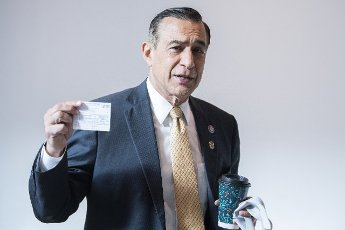 UNITED STATES - MAY 14: Rep. Darrell Issa, R-Calif., shows his vaccination card in the Capitol Visitor Center before Rep. Elise Stefanik, R-N.Y., won the election for House Republican Conference chair on Friday, May 14, 2021. (Photo By Tom Williams\/CQ Roll Call