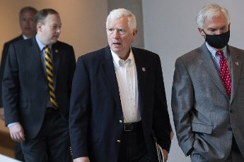 UNITED STATES - MAY 14: Rep. Mo Brooks, R-Ala., and Rep. Bob Latta, R-Ohio, right, are seen in the Capitol Visitor Center before Rep. Elise Stefanik, R-N.Y., won the election for House Republican Conference chair on Friday, May 14, 2021. (Photo By Tom Williams\/CQ Roll Call
