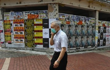Posters on the gate of an empty retail store in Causeway Bay. 30SEP20 SCMP \/ Nora