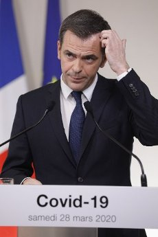 French Minister for Solidarity and Health Olivier Veran gestures as he speaks during a press conference in Paris, on March 28, 2020, on the eleventh day of a strict nationwide confinement in France seeking to halt the spread of the COVID-19 infection caused by the novel coronavirus. - The death toll from the coronavirus epidemic in Europe surged past 20,000 on March 28, 2020, even as the Chinese city where the outbreak began cautiously returned to life. Europe and the United States are facing a staggering increase in new cases of COVID-19 -- despite perhaps a third of humanity now living under lockdown.//04SIPA_1120.5853/2003282032/Credit:VAN DER HASSELT/POOL/SIPA/