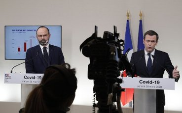 French Minister for Solidarity and Health Olivier Veran (R) speaks past French Prime Minister Edouard Philippe during a press conference in Paris, on March 28, 2020, on the eleventh day of a strict nationwide confinement in France seeking to halt the spread of the COVID-19 infection caused by the novel coronavirus. - The death toll from the coronavirus epidemic in Europe surged past 20,000 on March 28, 2020, even as the Chinese city where the outbreak began cautiously returned to life. Europe and the United States are facing a staggering increase in new cases of COVID-19 -- despite perhaps a third of humanity now living under lockdown.//04SIPA_1120.5841/2003282029/Credit:VAN DER HASSELT/POOL/SIPA/