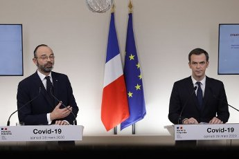 French Prime Minister Edouard Philippe (L) speaks past French Minister for Solidarity and Health Olivier Veran during a press conference in Paris, on March 28, 2020, on the eleventh day of a strict nationwide confinement in France seeking to halt the spread of the COVID-19 infection caused by the novel coronavirus. - The death toll from the coronavirus epidemic in Europe surged past 20,000 on March 28, 2020, even as the Chinese city where the outbreak began cautiously returned to life. Europe and the United States are facing a staggering increase in new cases of COVID-19 -- despite perhaps a third of humanity now living under lockdown.//04SIPA_1120.5844/2003282030/Credit:VAN DER HASSELT/POOL/SIPA/