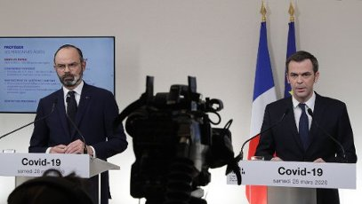French Minister for Solidarity and Health Olivier Veran (R) speaks past French Prime Minister Edouard Philippe during a press conference in Paris, on March 28, 2020, on the eleventh day of a strict nationwide confinement in France seeking to halt the spread of the COVID-19 infection caused by the novel coronavirus. - The death toll from the coronavirus epidemic in Europe surged past 20,000 on March 28, 2020, even as the Chinese city where the outbreak began cautiously returned to life. Europe and the United States are facing a staggering increase in new cases of COVID-19 -- despite perhaps a third of humanity now living under lockdown.//04SIPA_1120.5840/2003282029/Credit:VAN DER HASSELT/POOL/SIPA/