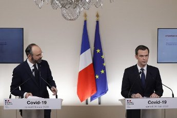 French Minister for Solidarity and Health Olivier Veran (CR) speaks past French Prime Minister Edouard Philippe during a press conference in Paris, on March 28, 2020, on the eleventh day of a strict nationwide confinement in France seeking to halt the spread of the COVID-19 infection caused by the novel coronavirus. - The death toll from the coronavirus epidemic in Europe surged past 20,000 on March 28, 2020, even as the Chinese city where the outbreak began cautiously returned to life. Europe and the United States are facing a staggering increase in new cases of COVID-19 -- despite perhaps a third of humanity now living under lockdown.//04SIPA_1120.5845/2003282030/Credit:VAN DER HASSELT/POOL/SIPA/