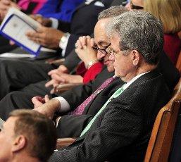 vUnited States Senators Chuck Schumer (Democrat of New York) and Tom Coburn (Republican of Oklahoma) sit together during U.S. President Barack Obama
