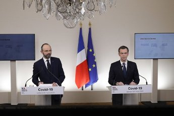 French Minister for Solidarity and Health Olivier Veran (R) speaks past French Prime Minister Edouard Philippe during a press conference in Paris, on March 28, 2020, on the eleventh day of a strict nationwide confinement in France seeking to halt the spread of the COVID-19 infection caused by the novel coronavirus. - The death toll from the coronavirus epidemic in Europe surged past 20,000 on March 28, 2020, even as the Chinese city where the outbreak began cautiously returned to life. Europe and the United States are facing a staggering increase in new cases of COVID-19 -- despite perhaps a third of humanity now living under lockdown.//04SIPA_1120.5846/2003282030/Credit:VAN DER HASSELT/POOL/SIPA/