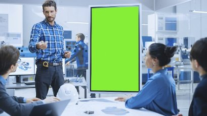 Engineer using a green screen in a factory meeting