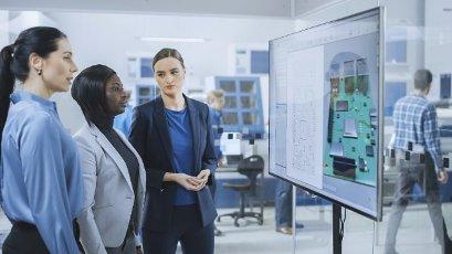 Engineers looking at a digital whiteboard