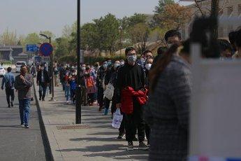 Tourists queue to enter the Liuhe Pagoda, a multi-story Chinese pagoda, Hangzhou city, east China