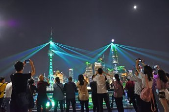 The Bund lights up to celebrate the 71st anniversary of the founding of the People\'s Republic of China. This year, the light show also celebrates the Mid-Autumn Festival, a traditional festival where the full moon symbolizes family reunion for many,
