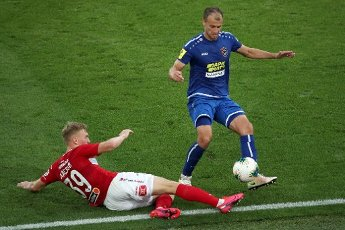 MOSCOW, RUSSIA â JULY 4, 2020: Spartak Moscow\'s Pavel Maslov (L) and FC Tambov\'s Yevgeny Shlyakov are in action in a 2019\/2020 Russian Premier League Round 26 football match between Spartak Moscow and FC Tambov at Otkrytie Arena. FC Tambov won 3-2