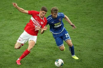 MOSCOW, RUSSIA â JULY 4, 2020: Spartak Moscow\'s Guus Til (L) and FC Tambov\'s Alexander Kapliyenko are in action in a 2019\/2020 Russian Premier League Round 26 football match between Spartak Moscow and FC Tambov at Otkrytie Arena. FC Tambov won 3-2