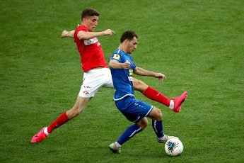 MOSCOW, RUSSIA â JULY 4, 2020: FC Tambov\'s Vladimir Kabakhidze (front) and Spartak Moscow\'s Guus Til are in action in a 2019\/2020 Russian Premier League Round 26 football match between Spartak Moscow and FC Tambov at Otkrytie Arena. FC Tambov won