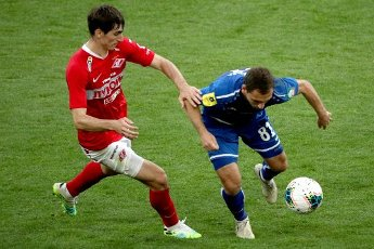MOSCOW, RUSSIA â JULY 4, 2020: Spartak Moscow\'s Zelimkhan Bakayev (L) and FC Tambov\'s Vladimir Kabakhidze are in action in a 2019\/2020 Russian Premier League Round 26 football match between Spartak Moscow and FC Tambov at Otkrytie Arena. FC Tambov