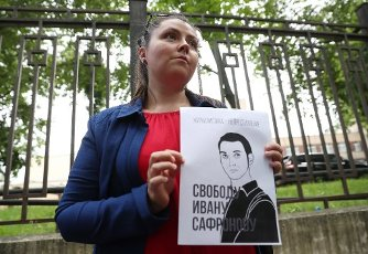 MOSCOW, RUSSIA - JULY 13, 2020: Journalist Sofya Rusova holds a poster reading \'Free Ivan Safronov\' during a rally by the Russian Union of Journalists outside the Lefortovo pre-trial detention facility in support of journalist Ivan Safronov, adviser