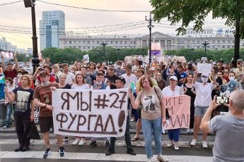 """KHABAROVSK, RUSSIA - JULY 16, 2020: Citizens hold a banner reading """"I\'m\/We\'re Furgal"""" during an unsanctioned mass rally in support of Khabarovsk Territory Governor Sergei Furgal who was detained on 9 July 2020 and charged with masterminding murders"""