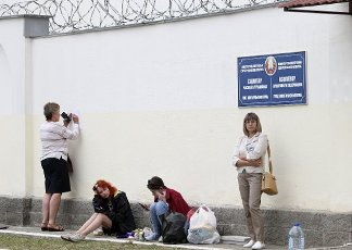 MINSK, BELARUS - AUGUST 12, 2020: Relatives of detained participants in mass protests are pictured outside a temporary detention facility. Mass protests against the results of the 2020 Belarusian presidential election erupted in major cities across