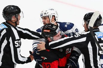 MOSCOW REGION, RUSSIA - AUGUST 12, 2020: HC Avangard Omsk\'s Jiri Sekac (front) and HC Dynamo Moscow\'s Andrei Alekseyev (background) fight in their friendly ice hockey match at Balashikha Arena. Stanislav Krasilnikov\/TASS