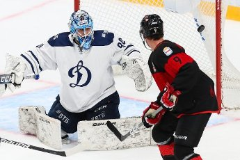 MOSCOW REGION, RUSSIA - AUGUST 12, 2020: HC Dynamo Moscow\'s goalie Georgy Kuznetsov (L) concedes a goal in a friendly ice hockey match against HC Avangard Omsk at Balashikha Arena. Also pictured: HC Avangard Omsk\'s Corban Knight (R). Stanislav