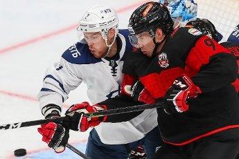 MOSCOW REGION, RUSSIA - AUGUST 12, 2020: HC Dynamo Moscow\'s Dmitry Korchemkin (L) and HC Avangard Omsk\'s Corban Knight fight for the puck in their friendly ice hockey match at Balashikha Arena. Stanislav Krasilnikov\/TASS
