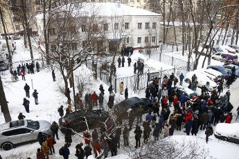 MOSCOW REGION, RUSSIA - JANUARY 18, 2021: People gather outside the 2nd Department of the Russian Interior Ministry Directorate for Khimki where opposition activist Alexei Navalny has been held after his detention upon arrival at Sheremetyevo