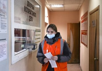 NOVOSIBIRSK, RUSSIA - MARCH 3, 2021: Polina Pishchulina, an assistant train driver at the West Siberian Railway, after receiving instructions at the TCh-32 depot. Polina Pishchulina, 20, has been working as an assistant train driver since January 14