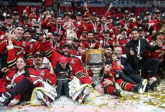MOSCOW REGION, RUSSIA - APRIL 28, 2021: Avangard\'s players pose for a group photo with the Gagarin Cup after their victory in Leg 6 of the 2020\/21 KHL Gagarin Cup Final playoff tie between Avangard Omsk and CSKA Moscow at Balashikha Arena. Sergei
