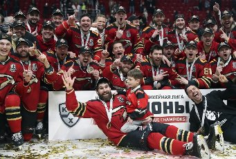 MOSCOW REGION, RUSSIA - APRIL 28, 2021: Avangard\'s players pose for a group photo with the trophy after their victory in Leg 6 of the 2020\/21 KHL Gagarin Cup Final playoff tie between Avangard Omsk and CSKA Moscow at Balashikha Arena. Sergei