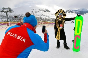 MURMANSK REGION, RUSSIA - MAY 3, 2021: A snowboarder in a costume poses for a photo during the Khibiny Bikini alpine festival at the Bolshoi Vudyavr (BigWood) ski resort in the Khibiny Mountains in the town of Kirovsk in Murmansk Region, northern