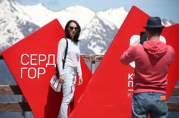 SOCHI, RUSSIA - MAY 6, 2021: A girl poses for a photo at the Krasnaya Polyana ski resort. Dmitry Feoktistov\/TASS
