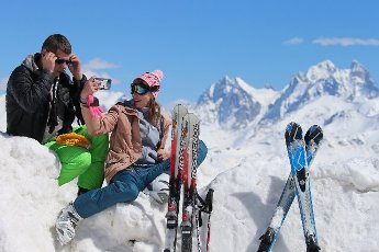 REPUBLIC OF KABARDINO-BALKARIA, RUSSIA â MAY 6, 2021: Skiers take a selfie at the Elbrus year-round resort in the Caucasus Mountains. Yelena Afonina\/TASS