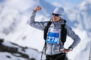 REPUBLIC OF KABARDINO-BALKARIA, RUSSIA â MAY 7, 2021: A woman poses for a photo after skyrunning from Azau Valley (2350m) to Western Peak (3780m) of Mount Elbrus during the 12th Red Fox Elbrus Race, an international festival of mountain extreme
