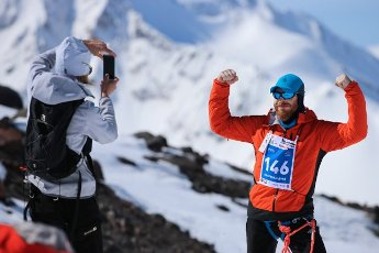 REPUBLIC OF KABARDINO-BALKARIA, RUSSIA â MAY 7, 2021: A man poses for a photo after skyrunning from Azau Valley (2350m) to Western Peak (3780m) of Mount Elbrus during the 12th Red Fox Elbrus Race, an international festival of mountain extreme